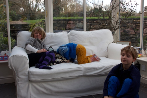 My son and his cousins playing a game of closing their eyes before opening some of the presents
